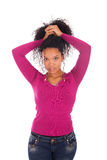 Young african american woman with long hair stock photography