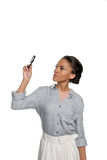 Young african american woman looking at magnifier isolated on white Stock Photography