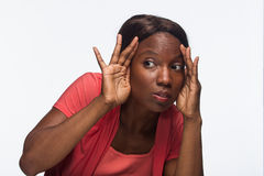 Young African American woman looking or taking a peek, horizontal Royalty Free Stock Photo