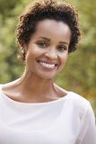 Young African American woman looks to camera, vertical Royalty Free Stock Photos