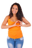 Young african american woman making a heart with hands Stock Photos