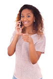 Young African American woman making a phone call on her smartpho Stock Image