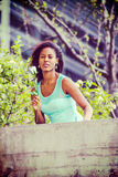Young African American woman missing you with white rose in New Royalty Free Stock Photos