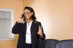 Young African-American woman on mobile phone Stock Images
