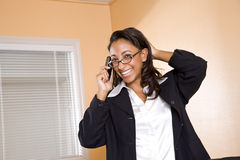 Young African-American woman on mobile phone Royalty Free Stock Image