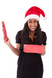Young African American woman opening a gift box Stock Photos