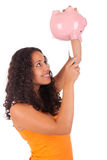Young african american woman with piggy bank Stock Photography