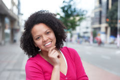 Young african american woman in pink shirt in the city Royalty Free Stock Photo