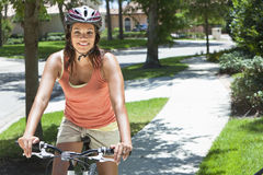 Young African American Woman Riding Bike Royalty Free Stock Images
