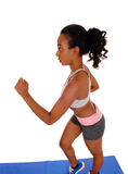 Young african american woman running. Royalty Free Stock Photography