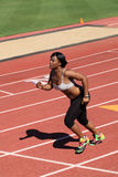 Young African American Woman Running on Track Royalty Free Stock Image