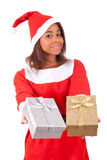 Young african american woman with  santa hat and gifts Stock Photos