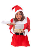 Young african american woman with  santa hat and gifts Stock Image