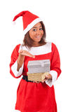 Young african american woman with  santa hat and gifts Royalty Free Stock Photo