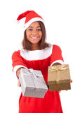 Young african american woman with  santa hat and gifts Stock Photo
