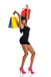 Young African American woman with shopping bags Stock Photography