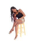 Young African American woman sitting on chair. Royalty Free Stock Photos