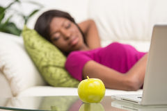 Young African American woman sleeping on sofa. Royalty Free Stock Photography