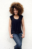 Young african american woman smiling with afro hair stock photography