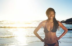 Young african american woman smiling at the beach Royalty Free Stock Photography