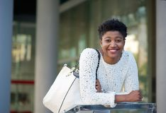 Young african american woman smiling in the city Stock Image