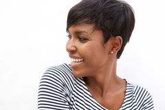 Young african american woman smiling and looking away Stock Image