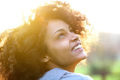 Young african american woman smiling and looking up Stock Photography