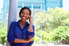 Young african american woman smiling with mobile phone Royalty Free Stock Photo