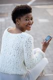 Young african american woman smiling with mobile phone Royalty Free Stock Image