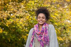 Young african american woman standing outdoors in autumn Stock Photography