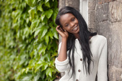 Young African American woman standing and smiling Stock Photo