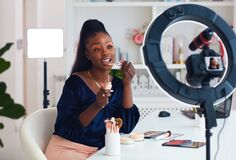 Free Young African American Woman Streaming A Beauty Vlog From Home, Online Content Creator Stock Photos - 210466613