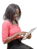 Young african american woman with a tablet Royalty Free Stock Photography