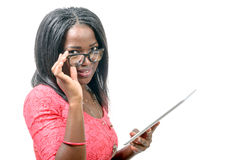 Young african american woman with a tablet Stock Images