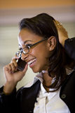 Young African-American woman talking on cellphone Royalty Free Stock Photos