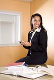 Young African-American woman texting and studying Stock Photos