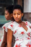 Young African American Woman thinking by mirror Stock Photo