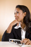 Young African-American woman thinking and smiling Royalty Free Stock Photos