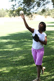 Young African American Woman Throwing baseball Park Stock Photography