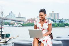 Young African American Woman traveling, working in New York stock photography