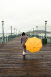 Young african american woman walking on the pier Stock Image