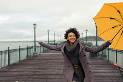 Young african american woman walking on the pier Stock Images