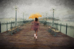 Young african american woman walking on the pier Stock Photos