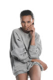 Young african american woman wearing grey sweater looking at camera. Serious young african american woman wearing grey sweater looking at camera Royalty Free Stock Images