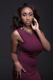 Young African American woman wearing red dress. Royalty Free Stock Photos