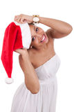 Young African American woman wearing a santa hat Stock Photo