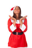 Young African American woman wearing a santa hat Royalty Free Stock Photos