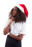 Young African American woman wearing a santa hat Royalty Free Stock Image