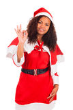 Young African American woman wearing à santa hat Royalty Free Stock Images