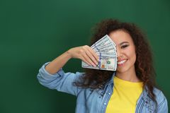 Free Young African-American Woman With Money On Color Background Stock Images - 144309304